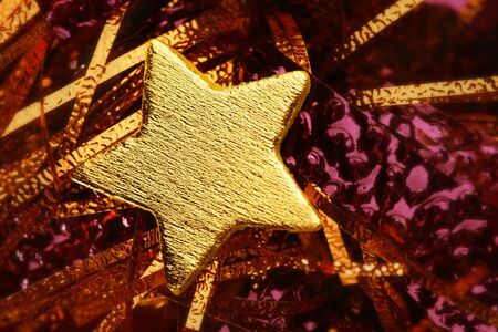 Christmas golden decoration with gold star over red background photo