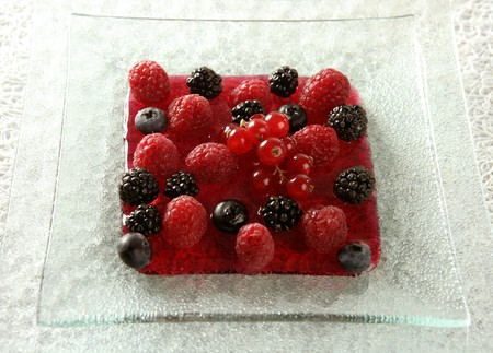 varied: Berries, mixed dessert with strwberry syrup Stock Photo