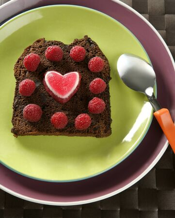 Lovely raspberryes and heart cake. Valentine. Brown bread photo