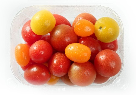 varied: Little cherry varied multi color tomatoes, at studio, white background Stock Photo