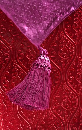 Red wallpaper, and pink purple braid, shiny and decorated eastern pattern background photo