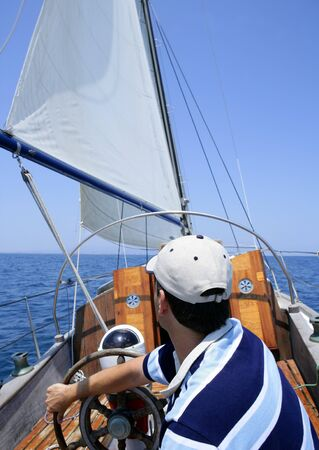 Sailor sailing in the sea. Sailboat over mediterranean blue saltwater Stock Photo - 4085546