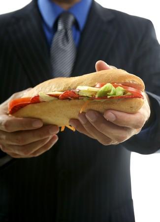 businessman eating junk fast food, studio white background Stock Photo - 4093964