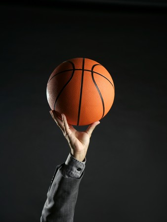 Businessman with basketball ball, teamwork, leadership metaphor photo