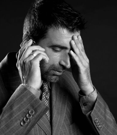 businessman stress with headache and mobile phone over black Stock Photo - 4097069