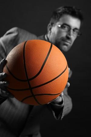 Businessman with basketball ball, teamwork, leadership metaphor photo