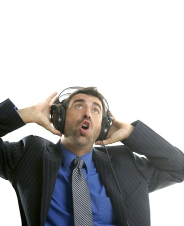 Businessman hearing and singing music with headphones, take a break photo