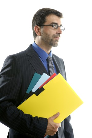 Businessman and color folders over white studio background, yellow photo
