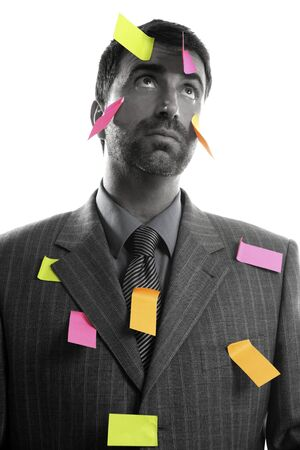 Businessman full of memo stock message notes over white studio background photo