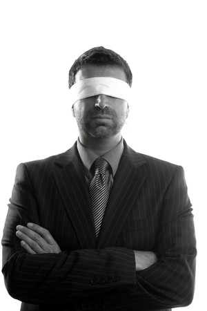 blind people: Blindfolded businessman over white background, conceptual image