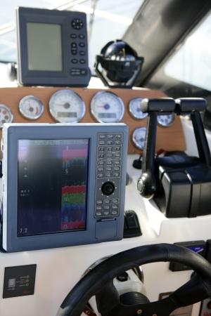 Boat control bridge, plotter, fishfinder, radar, power, compass, interior white photo