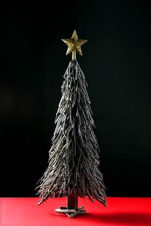 Original wood sticks christmas tree, simple at studio background photo