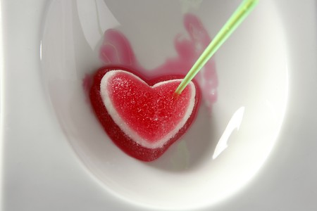 Eat a jelly strawberry bloody heart romantic metaphor Stock Photo - 4117388