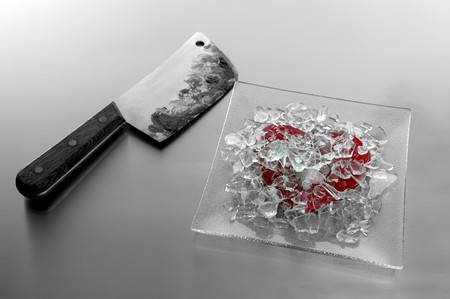 Broken sweet candy red heart with bloody knife, the murder weapon photo