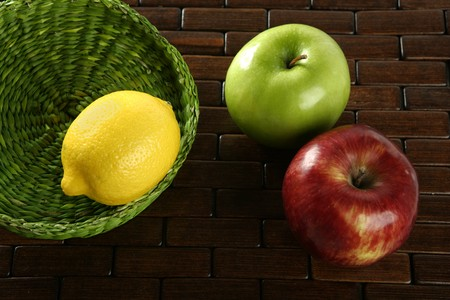 varied: Varied fruits and vegetables, yellow lemon and apple Stock Photo