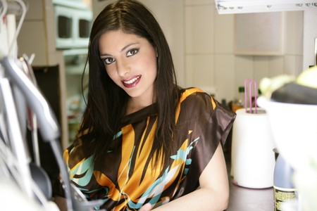 beautiful fashion elegant indian woman on the kitchen photo