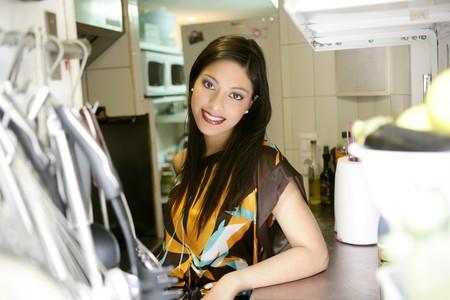 beautiful fashion elegant indian woman on the kitchen photo