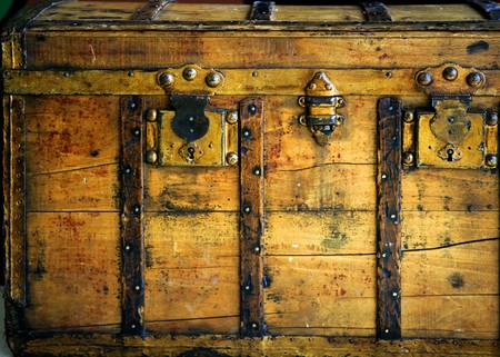 Old wooden chest, trunk in golden color and rusty Stock Photo