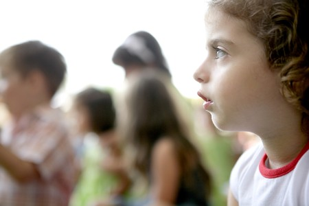 Spectator children observing spectacle. Looking at the show photo
