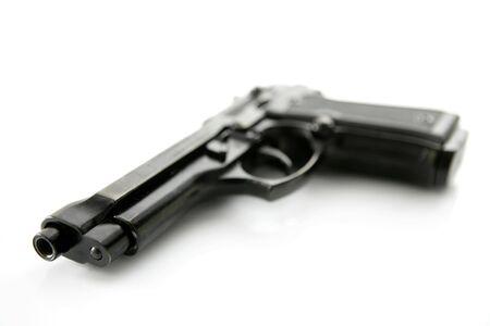black hand gun pistol over white background, selective focus, studio shot photo