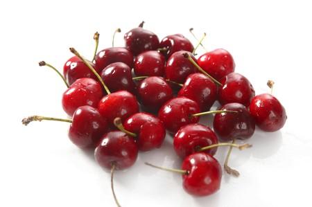 cherry red wet fruits macro on white studio isolated Stock Photo - 4170108