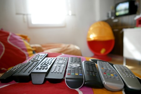 too: many remote control for only one house, excess technology metaphor