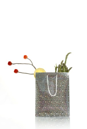 surreal silver vegetables shopping food bag isolated over white photo