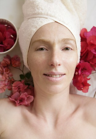 Spa flowers relaxing massage theraphy. Female thirty to fourty years Stock Photo - 4201525