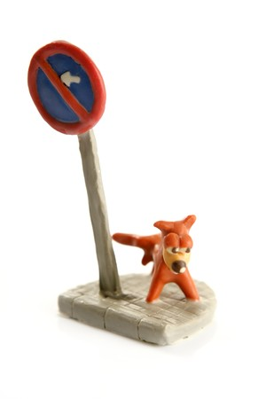 pee: plasticine handmade dog, pee on signal pole isolated over white