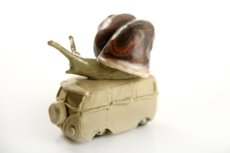 Handmade plasticine vw van with snail over, isolated on white photo