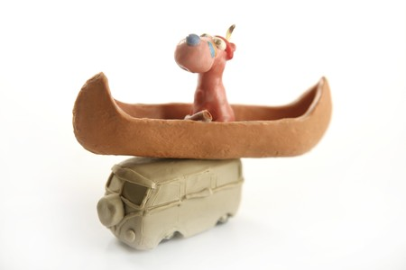 Handmade plasticine vw van with indian canoe and dog over photo