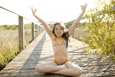 beautiful relaxed zen teen meditation in bikini, summer park outdoors