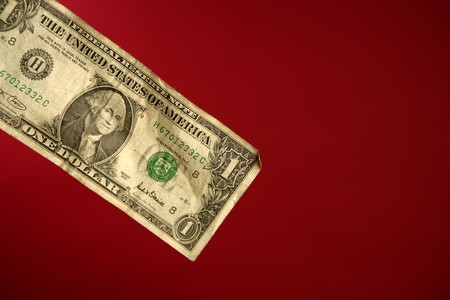 One dollar note over red background, studio crop shot Stock Photo - 4238323