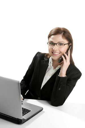 Businesswoman with laptop happy talking with mobile phone  photo