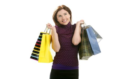 Shopaholic woman shopping with colorful bags isoalted on white photo