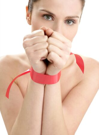 Beauty cosmetic portrait of funny tied hands woman with red tape photo