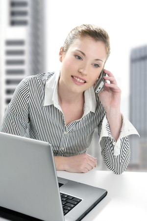 Businesswoman with laptop happy talking with mobile phone Stock Photo - 4280315