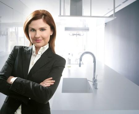 Businesswoman portrait at home in white kitchen photo