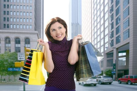 Shopper smiling woman shopping happy on the city photo