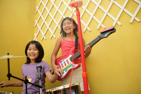 live rock concert at two home little oriental girls singing and playing guitar Stock Photo - 4280490