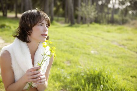 beautiful woman in a spring landscape, yellow flowers Stock Photo - 4280353