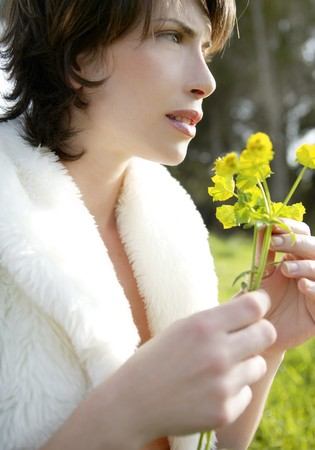 beautiful woman in a spring landscape, yellow flowers Stock Photo - 4280351