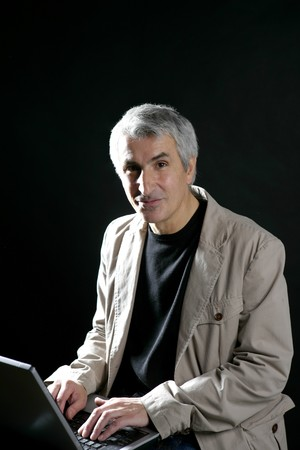 businessman working laptop computer, senior gray hair photo