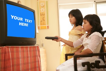 two asian girls dressed as princess, tv remote control, blue copy space photo
