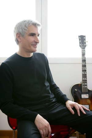 hair band: Senior jazz musician portrait, with his guitar in background