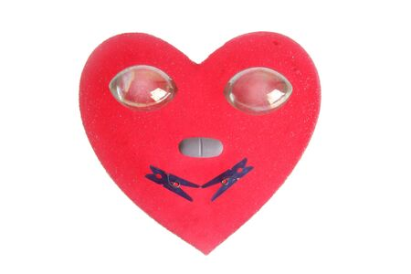 funny heart face, candy end everyday items , glass eyes, isolated on white photo