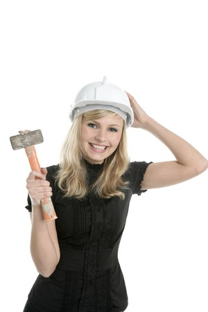 Young blond businesswoman, hammer helmet isolated on white photo