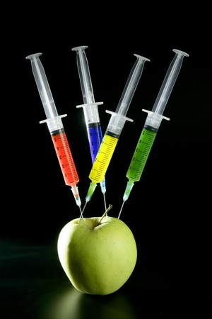 Bio genetics research of food , apple manipulation with syringe photo