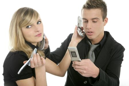Stress with phone calls between a business couple with many telephones photo
