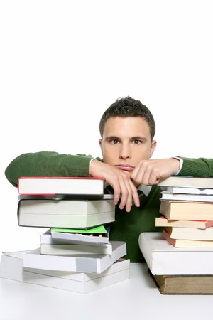 student reading: Young unhappy student with much homework and stacked books over white Stock Photo